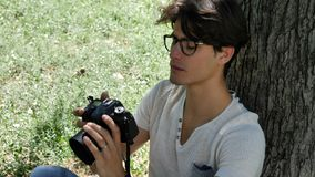 Handsome young male photographer taking photograph stock photo