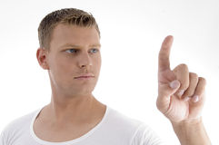 Handsome young male pointing. Against white background Royalty Free Stock Photography