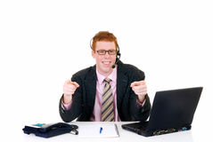 Handsome young male secretary. Handsome red-headed smiling young male secretary, help desk assistant with headset. White background, studio shot Royalty Free Stock Photo