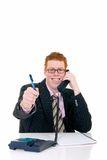 Handsome young male secretary. Handsome red-headed smiling young male secretary, help desk assistant making phone call. White background, studio shot Stock Image