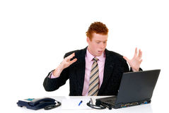 Handsome young male secretary. Handsome red-headed stressed young male secretary, help desk assistant. White background, studio shot Royalty Free Stock Photos