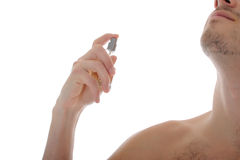 Handsome young male spray perfume on his skin Royalty Free Stock Image