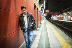 Handsome young male traveler in train station Royalty Free Stock Photo