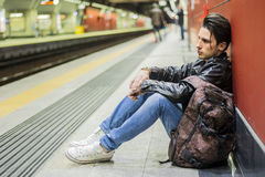Handsome young male traveler in train station Royalty Free Stock Images