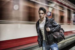 Handsome young male traveler in train station Royalty Free Stock Image