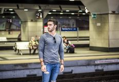 Handsome young male traveler in train station. Looking to a side Stock Images