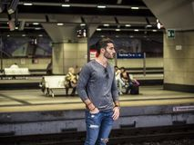 Handsome young male traveler in train station. Looking to a side Stock Photo