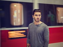 Handsome young male traveler in train station stock images