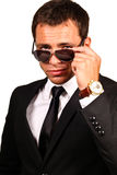 Handsome young man. Portrait of a handsome young man in elegant suit and sunglasses stock photography