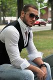 Handsome young man. This picture represents a handsome young man sitting on a park bench Stock Images