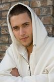Handsome young man. Wearing a hooded sweatshirt royalty free stock photo
