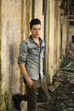 Handsome young man in abandoned, run down building Royalty Free Stock Images