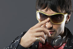 Handsome Young Man Adjusting Sunglasses Stock Photography