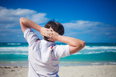 Handsome young man  against  beach background Royalty Free Stock Photography