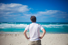 Handsome young man  against bright beach Stock Photo