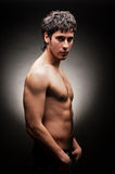 Handsome young man against dark background Royalty Free Stock Photo