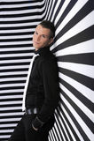 Handsome young man against striped B&W background Royalty Free Stock Photo
