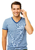 Handsome Young Man Answering Smart Phone Stock Photo