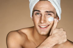 Free Handsome Young Man Applying Cream To His Face. Stock Photography - 88759652