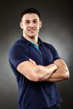Handsome young man with arms folded Royalty Free Stock Image