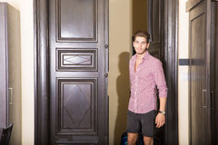 Handsome young man arriving to a hotel Royalty Free Stock Photos