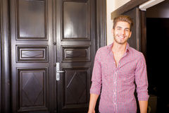 Handsome young man arriving to a hotel Stock Photography