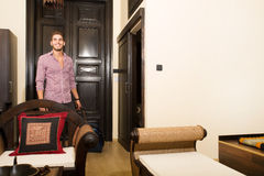 Handsome young man arriving to a hotel Royalty Free Stock Photography