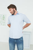 Handsome young man with back pain Royalty Free Stock Photo