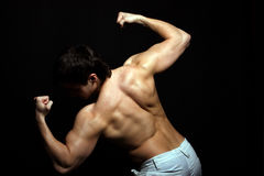 Handsome young man from the back in the studio Stock Photo