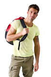 Handsome young man with backpack, isolated on white Royalty Free Stock Photos