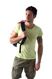 Handsome young man with backpack, isolated on white Stock Photos