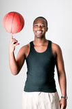 Handsome young man with a basket ball Royalty Free Stock Photo