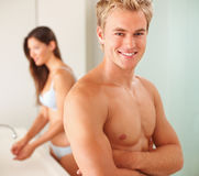 Handsome young man with  in the bathroom Royalty Free Stock Image