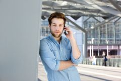 Handsome young man with beard calling by mobile phone Royalty Free Stock Image