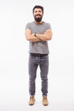 Handsome young man with beard full heigh with crossed hands Royalty Free Stock Photos