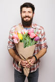 Handsome young man with beard  and nice bouquet of flowers Royalty Free Stock Photo