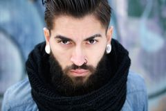 Handsome young man with beard and piercing Stock Images