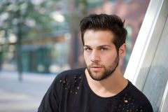 Handsome young man with beard posing outdoors. Close up portrait handsome young man with beard posing outdoors royalty free stock photos