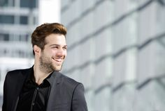 Handsome young man with beard smiling. Close up portrait of a handsome young man with beard smiling stock images