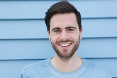 Handsome young man with beard smiling Royalty Free Stock Image