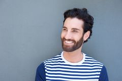Handsome young man with beard smiling Royalty Free Stock Images