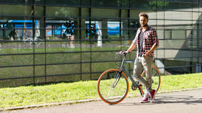 Handsome young man with the bike Stock Photo