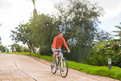 Handsome young man on bike in the park. Bicycle, leisure and people concept. Handsome young man on bike in the park. Bicycle, leisure and people concept Stock Photos