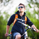 Handsome Young Man Biking Royalty Free Stock Image