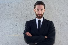 Handsome young man in black business suit Stock Images