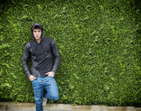 Handsome young man in black hoodie sweater standing outdoor Royalty Free Stock Photos