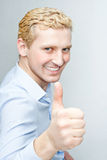 Handsome young man in a blue shirt Stock Photography