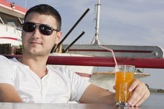 Handsome young man on boat Royalty Free Stock Photos