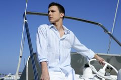 Handsome young man on boat, summer vacation Royalty Free Stock Photos