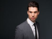 Handsome young man in business suit royalty free stock image
